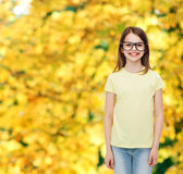 Smiling cute little girl in black eyeglasses Royalty Free Stock Photography