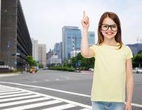 Smiling cute little girl in black eyeglasses Stock Photo