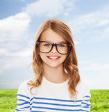 Smiling cute little girl with black eyeglasses Royalty Free Stock Images
