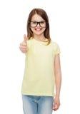 Smiling cute little girl in black eyeglasses Stock Photos