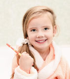 Smiling cute little girl brushing teeth Stock Photos