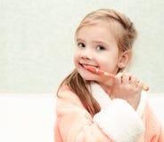 Smiling cute little girl brushing teeth Royalty Free Stock Photo