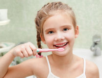 Smiling cute little girl brushing teeth Royalty Free Stock Photography