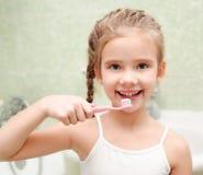 Smiling cute little girl brushing teeth Royalty Free Stock Image