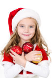 Smiling cute little girl with christmas balls Stock Photos