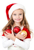 Smiling cute little girl with christmas balls Royalty Free Stock Photo