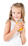 Smiling cute little girl with glass of juice isolated Stock Image