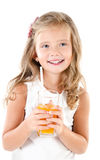 Smiling cute little girl with glass of juice isolated Stock Images