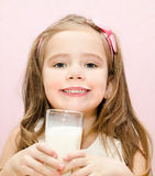 Smiling cute little girl with glass of milk Royalty Free Stock Photography