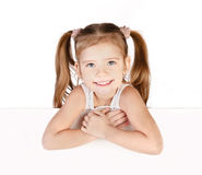 Smiling cute little girl isolated stock images