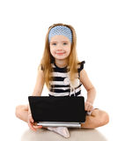 Smiling cute little girl with laptop isolated Stock Image