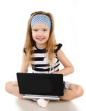 Smiling cute little girl with laptop isolated Stock Photography