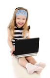 Smiling cute little girl with laptop  Royalty Free Stock Image