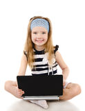 Smiling cute little girl with laptop  Stock Photography