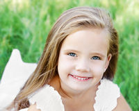 Smiling cute little girl on the meadow Royalty Free Stock Photos