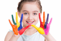 Smiling cute little girl with painted hands. Stock Images