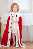 Smiling cute little girl posing in royal mantle Stock Image
