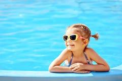 Cute girl in pool royalty free stock photo