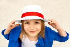 Smiling cute little girl in white hat. Happiness, fashionable concept Royalty Free Stock Images