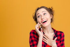 Smiling cute lovely young woman talking on mobile phone Stock Images