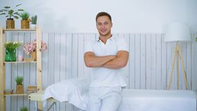 Smiling cute male masseur portrait and beautiful young woman customer on table in spa salon. Smiling cute male masseur portrait and beautiful woman customer on stock video footage