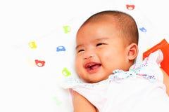 Smiling newborn infant baby girl on white bed Stock Photo