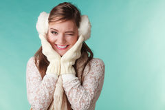 Smiling cute pretty woman girl in earmuffs. Stock Photos