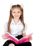 Smiling cute schoolgirl with book isolated Royalty Free Stock Photo