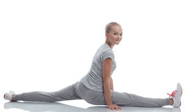 Smiling cute teenage girl doing stretching Royalty Free Stock Photography