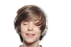 Smiling cute teenager boy with headphones Stock Photos
