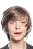 Smiling cute teenager boy with headphones Royalty Free Stock Photo