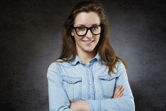 Smiling cute teenager in nerdy glasses Royalty Free Stock Photo