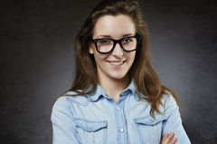Smiling cute teenager in nerdy glasses Royalty Free Stock Image
