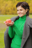 Smiling cute woman bites ripe apple Stock Image