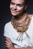 Smiling cute woman with gold necklace Royalty Free Stock Photos