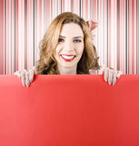 Smiling cute woman holding blank red card Royalty Free Stock Image