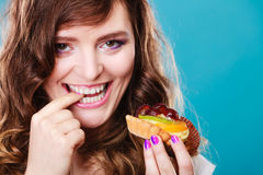 Smiling cute woman holds fruit cake in hand Stock Image