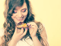 Smiling cute woman holds fruit cake in hand Stock Photo