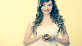 Smiling cute woman holds fruit cake in hand Royalty Free Stock Images