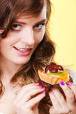 Smiling cute woman holds fruit cake in hand Stock Photos
