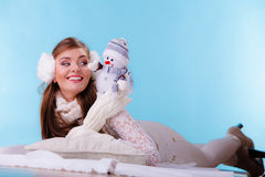 Smiling cute woman with little snowman. Winter. Royalty Free Stock Photos