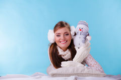Smiling cute woman with little snowman. Winter. Royalty Free Stock Photo