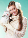 Smiling cute woman with little snowman. Winter. Stock Photos