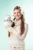 Smiling cute woman with little snowman. Winter. Stock Images