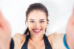 Smiling cute woman making selfie photo royalty free stock photography
