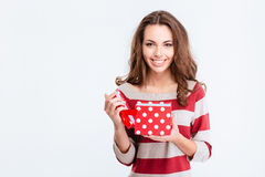 Smiling cute woman opening gift box and looking at camera Royalty Free Stock Images