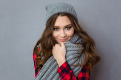 Smiling cute woman with scarf and hat Royalty Free Stock Images
