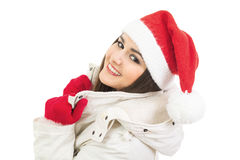 Smiling cute young woman with Santa hat Royalty Free Stock Photography