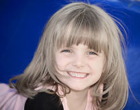 Smiling Cutie. Little girl full of smiles Stock Photography