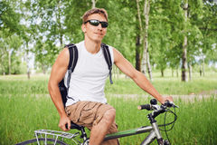 Smiling cyclist on bike Stock Image
